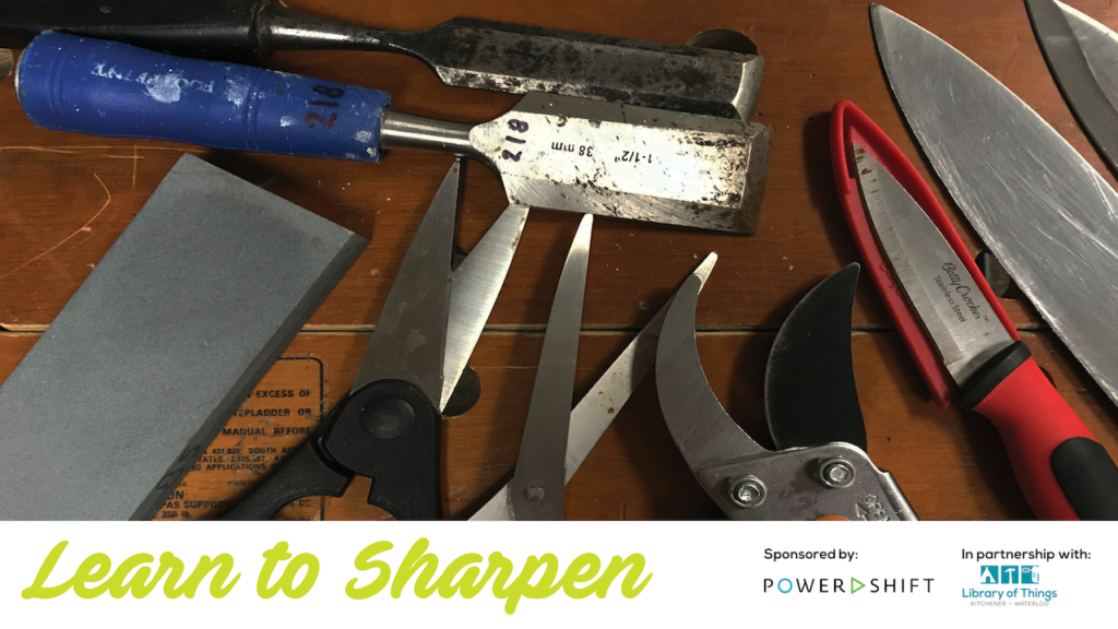 knife, scissors, garden pruners and chisel lay on a work bench ready for sharpening
